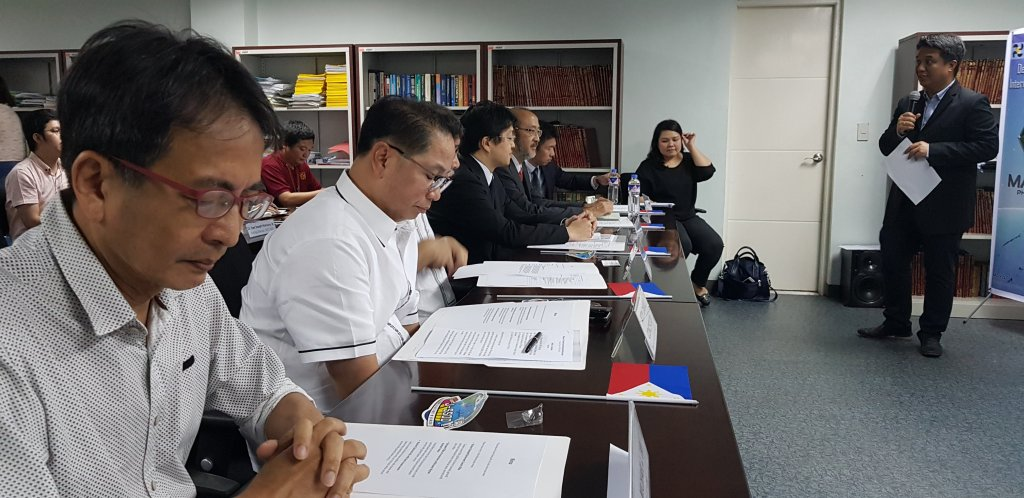 UP EEEI Director Richard Hizon gives a briefing to guests, including UPD Chancellor Michael Tan (leftmost) and UP President Danilo Concepcion (2nd from left), on Maya-1. (Photo by Jun Madrid, UP MPRO)