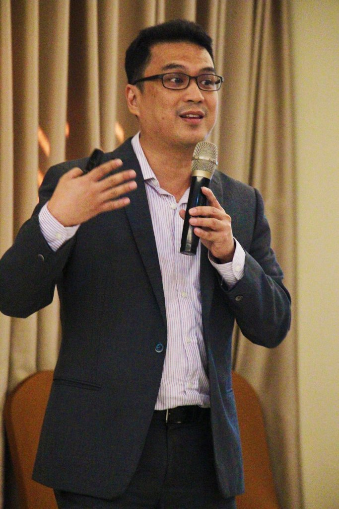 """Dr. Erwin Gaspar Alampay, UP professor and director of CLRG NCPAG, summarizes the team's research findings and recommendations in the forum, """"Enabling the Disabled: Assessment of PDAO Implementation by LGUs"""", held at the Sequoia Hotel in Diliman, Quezon City on June 19, 2018. (Photo by Jun Madrid, UP MPRO)"""