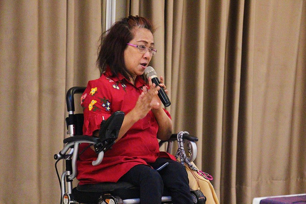 Ms. Carmen Reyes-Zubiaga, executive director of the National Council on Disability Affairs, provides a recap of the PWD sector's campaigns in line with RA 10070 and her assessment of and recommendations for the research project. (Photo by Jun Madrid, UP MPRO)