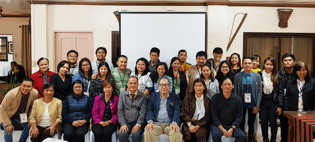 """UP System and UP Baguio officials pose with the media-participants during UP Baguio's Media Brunch. Sitting in the front row, from left to right: UPB faculty-researchers who presented their research that day—Dr. Teodora D. Balongcod, Dr. Analyn Salvador-Amores, and UPB Vice-Chancellor for Academic Affairs Corazon L. Abansi; UPB Chancellor Raymundo Rovillos; UP Vice-President for Public Affairs Jose """"Butch"""" Dalisay; CoST-UP program leader and UP Diliman College of Mass Communication Dean Elenia E. Pernia; CoST-UP program member and UP Diliman College of Fine Arts Dean Leonardo Rosete. (Photo by Celeste Llaneta, UP MPRO)"""