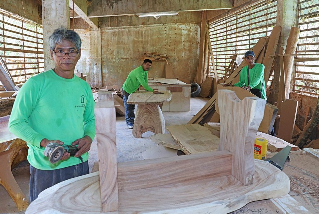 At work in the makeshift workshop and storage area at the Agricultural Training Institute-National Training Center Residence Hall: from left to right, master carpenter Aurelio Heredia, master carpenter Roger Villegas, and foreman Luis Dela Cruz (Photo by Misael Bacani, UP MPRO)