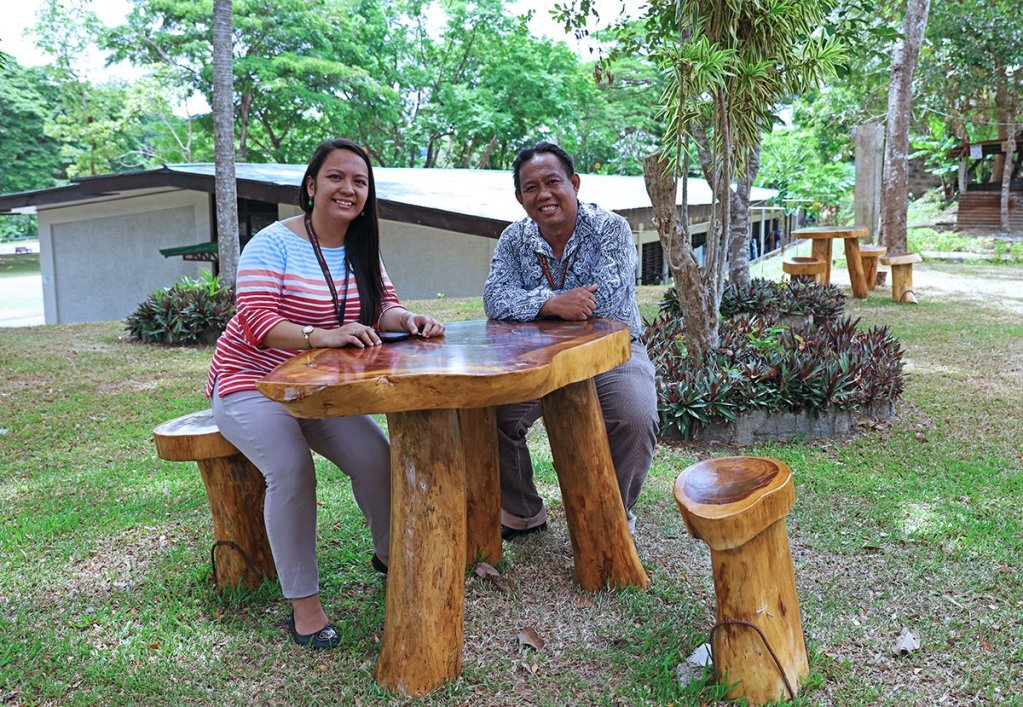 Honey Faith Roa-Evangelista, dorm manager of the Agricultural Credit and Cooperatives Institute (ACCI) and International House Residence Halls, and UHO Director Zoilo Belano Jr. in a furniture set outside ACCI dorm complex (Photo by Misael Bacani, UP MPRO)