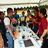 Students flock to a booth on urban survival. (Photo by Bong Arboleda, UP MPRO)