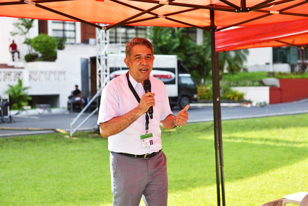 Prof. Nathaniel Diola reports on the College of Engineering's DRRM initiatives. (Photo by Bong Arboleda, UP MPRO)