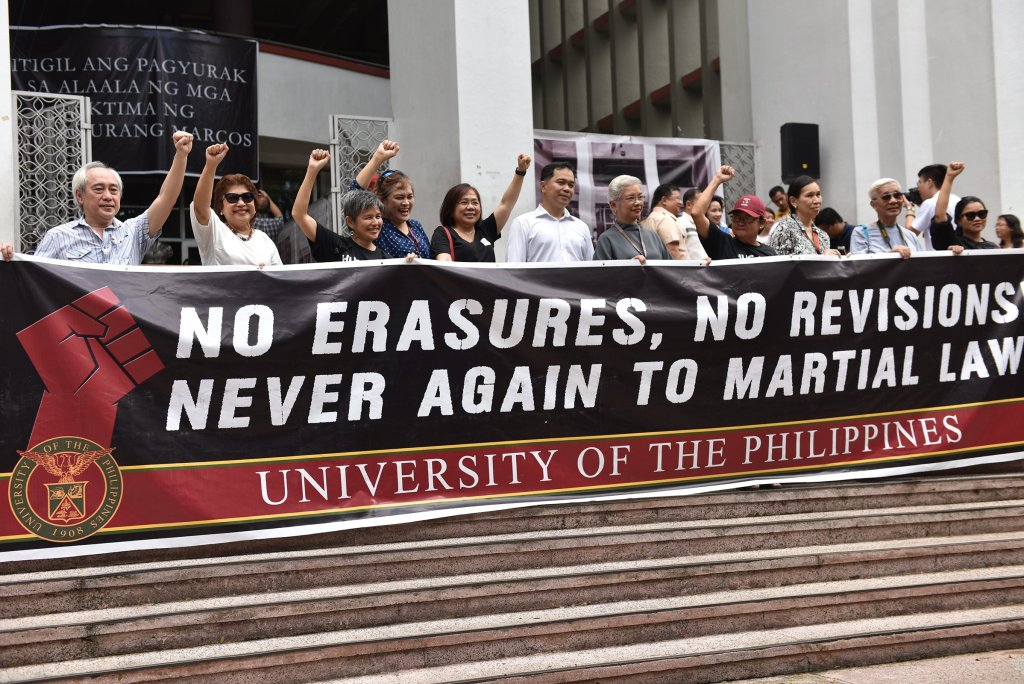 UP professors, with Bagong Alyansang Makabayan Chair Carol Araullo and former Faculty Regent Judy Taguiwalo, make a stand during UP's first UP Day of Remembrance. Photo by Bong Arboleda, MPRO