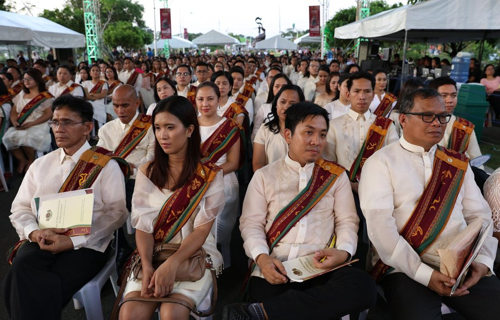 The UP Open University Class of 2018 listens to the commencement speaker, Dr. J. Prospero de Vera III, Officer-in-Charge of the Commission on Higher Education. (Photo by Misael Bacani, UP MPRO)