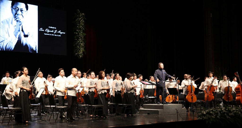 """Maestro Yoshikazu Fukumura and the PPO prepare to take a bow after the """"1812 Overture."""" (Photo by Misael Bacani, UP MPRO)"""
