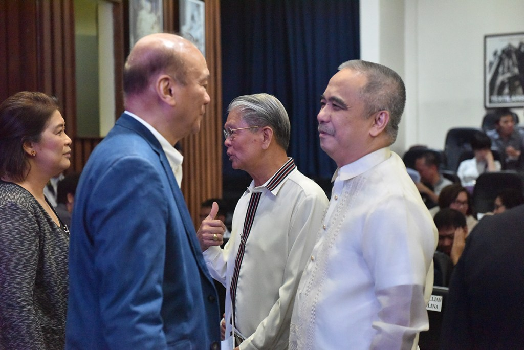 Sec. Ernesto Pernia (center) with PAASE President Joel Cuello and Dr. Gisela Concepcion. (Photo by Bong Arboleda, UP MPRO)