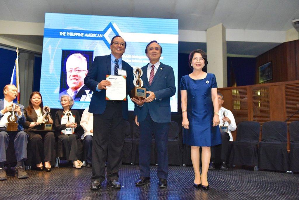 Sec. Ernesto Pernia (center) with PAASE President Joel Cuello and Dr. Gisela Concepcion. (Photo by Bong Arboleda, UP MPRO)