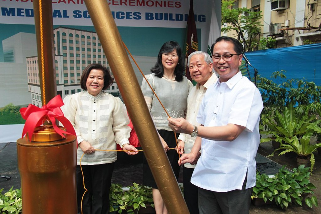 UP College of Medicine Dean Charlotte Chiong, UP Manila Chancellor Carmencita Padilla, UP Medical Alumni Foundation Inc. Chairman and President Rody Sy, and UP President Danilo Concepcion lower the time capsule during the ground-breaking for the UP College of Medicine Medical Sciences Building. (Photo by Jun Madrid, UP MPRO)