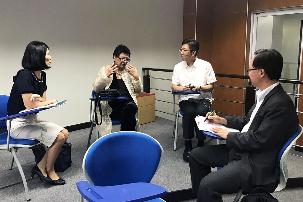 Former UPOU Chancellor and Professor Emeritus Grace Alfonso (center) with Southern Taiwan delegates in one of the discussions. (Photo by UP OIL)
