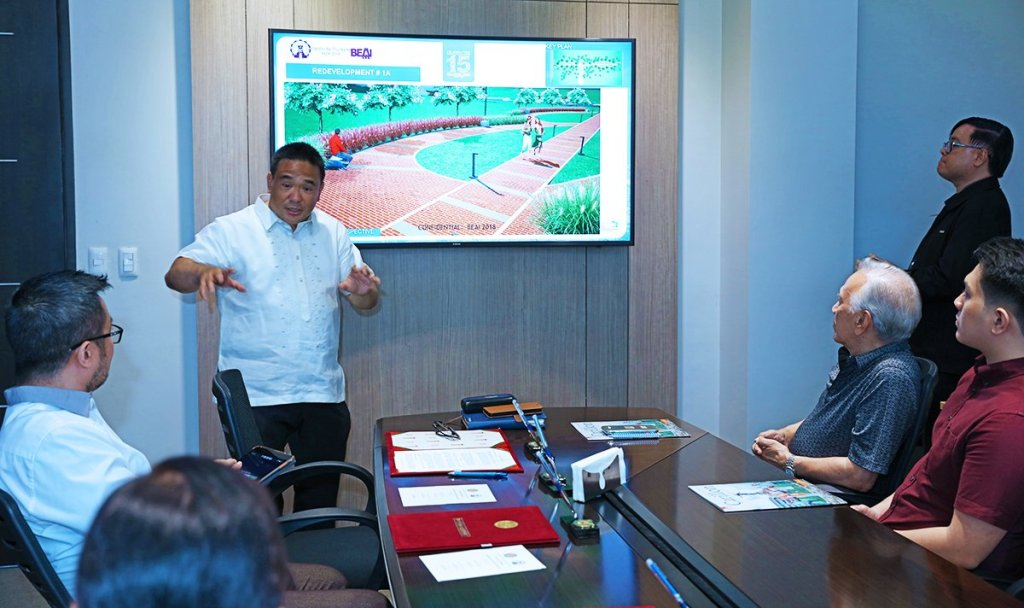 Beta Epsilon Alumni Association Vice President Leonardo Jose Berba presents initial designs for the upgraded Beta Way, during a short program in the Office of the UP President. (Photo by Misael Bacani, UP MPRO)