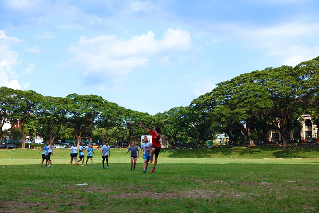 The UP Diliman Sunken Garden spreading out for a game of frisbee; and the UP Diliman Amphitheater embracing the public on a leisurely day on the grass. Photos by Misael Bacani and Jo. Lontoc