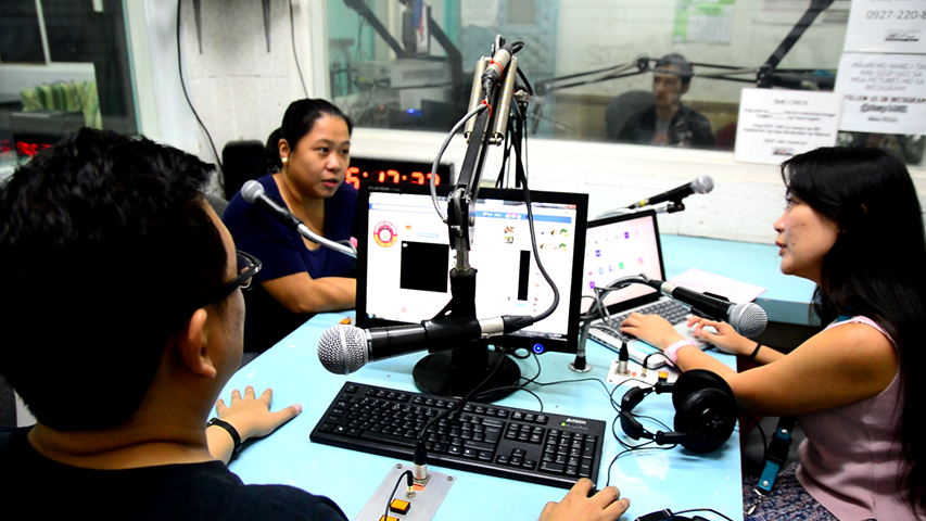 Yacat and Parcon with College of Human Kinetics Instructor Mona Maghanoy at the DZUP radio booth. (Photo by KIM Quilinguing, UP MPRO)