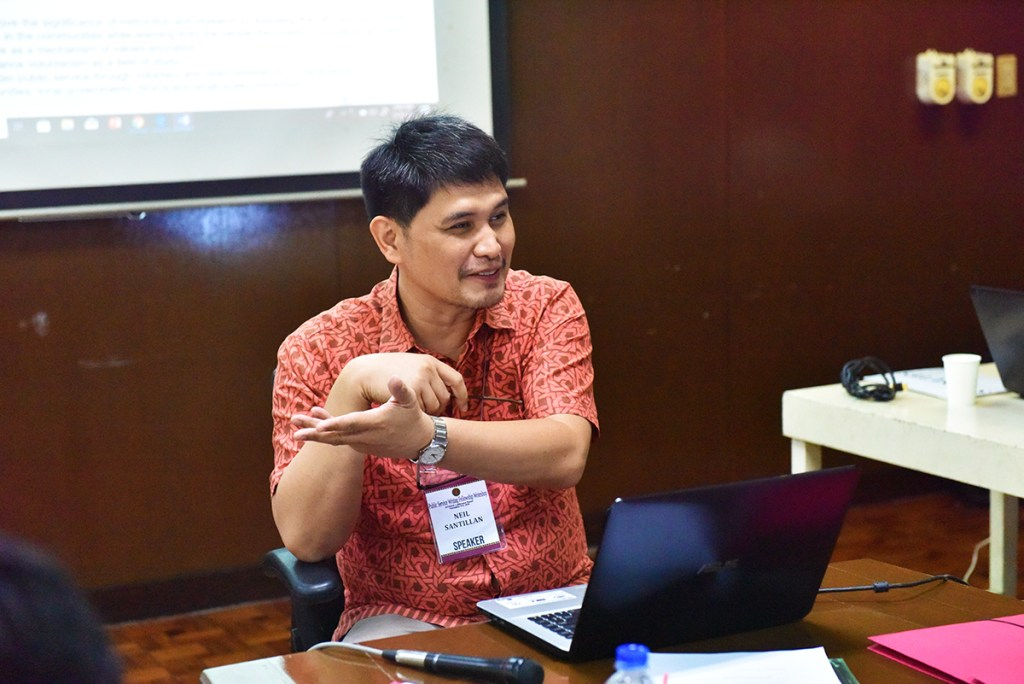 Prof. Neil Martial Santillan of the UP Diliman Department of History gives a personal account of using extension output for a research work. (Photo by Bong Arboleda, UP MPRO)