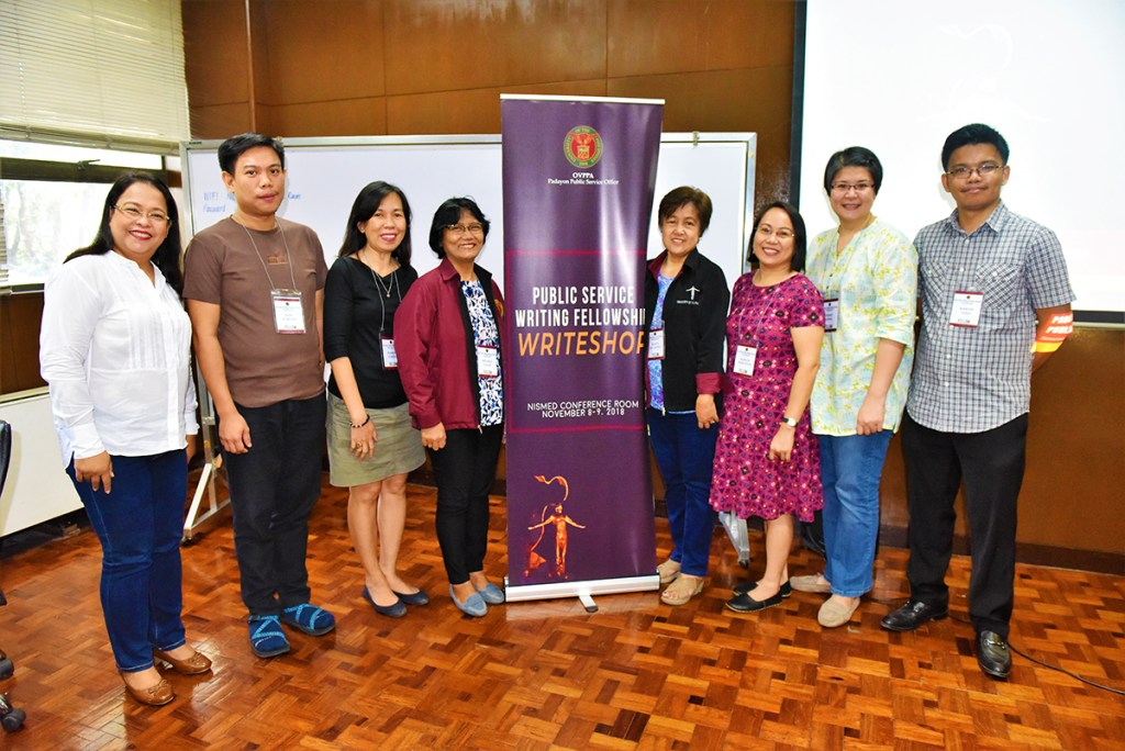 The Padayon writing fellows with Director Jeanette Yasol-Naval: Jude Vincent Parcon of UP Visayas, Rhonna Marie Vereña of UP Open University, Belinda Lalap and Nenita de Castro of UP Los Baños, Marilou Montiflor of UP Mindanao, Peñafrancia Ching of UP Manila, and Marion Micah Tinio of UP Diliman. Lucia Tangi of UP Diliman is not in photo. (Photo by Bong Arboleda, UP MPRO)