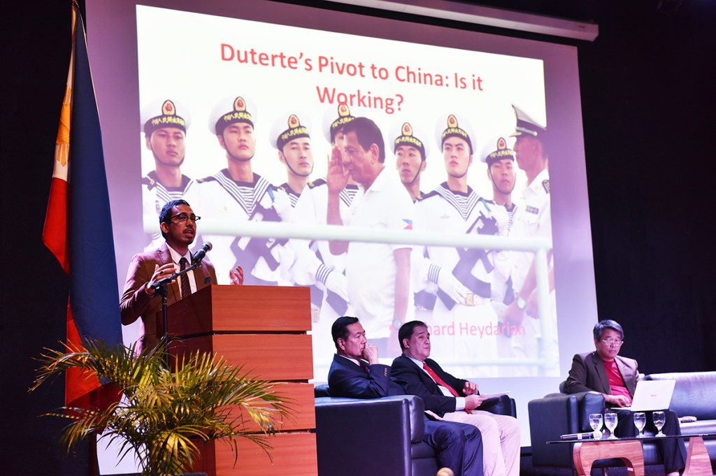Author and columnist on international relations, Richard Heydarian, provides his opinion on the West Philippine Sea dispute, as part of a panel composed of the keynote speaker, Senior Associate Justice Antonio Carpio, Renato Cruz de Castro of the De La Salle University International Studies Department, and Jay Batongbacal of the University of the Philippines Institute for Maritime Affairs and Law of the Sea. (Photo by Bong Arboleda, UP MPRO)