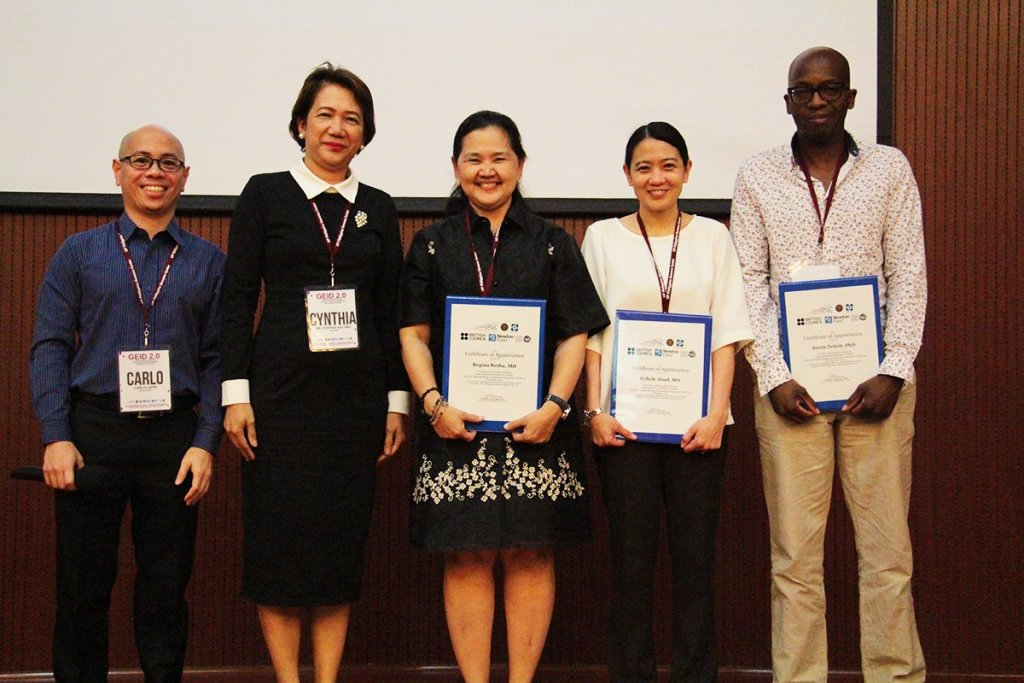 Philippine Genome Center Director Cynthia Saloma (2nd from left) with the afternoon session's presenters (Photo by Jun Madrid, UP MPRO)