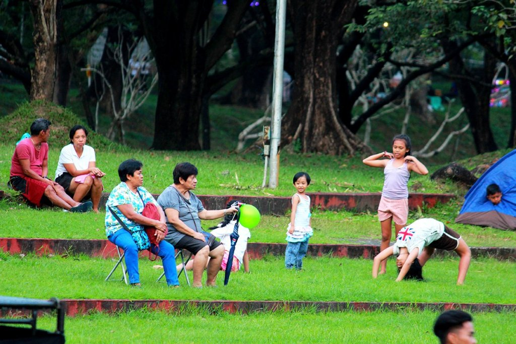 The UP Diliman Sunken Garden spreading out for a game of frisbee; and the UP Diliman Amphitheater embracing the public on a leisurely day on the grass. (Photos by Misael Bacani and Jo. Lontoc, UP MPRO)