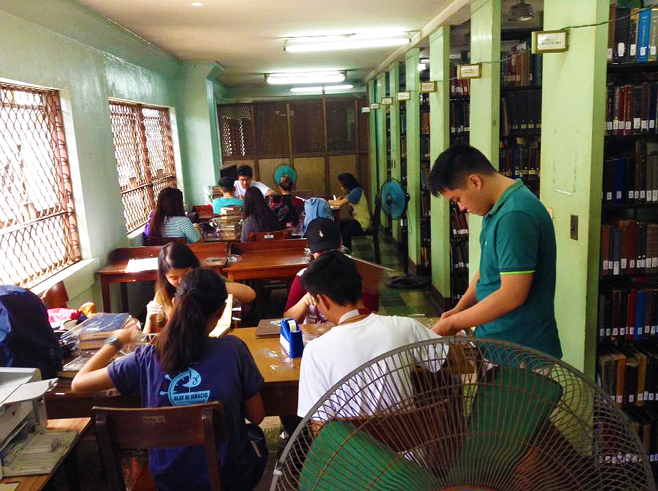 CSSP NSTP students help CSSP Library inside the Main Library to cover books and recover its backlog. (Photos from Rhoell Rondilla)