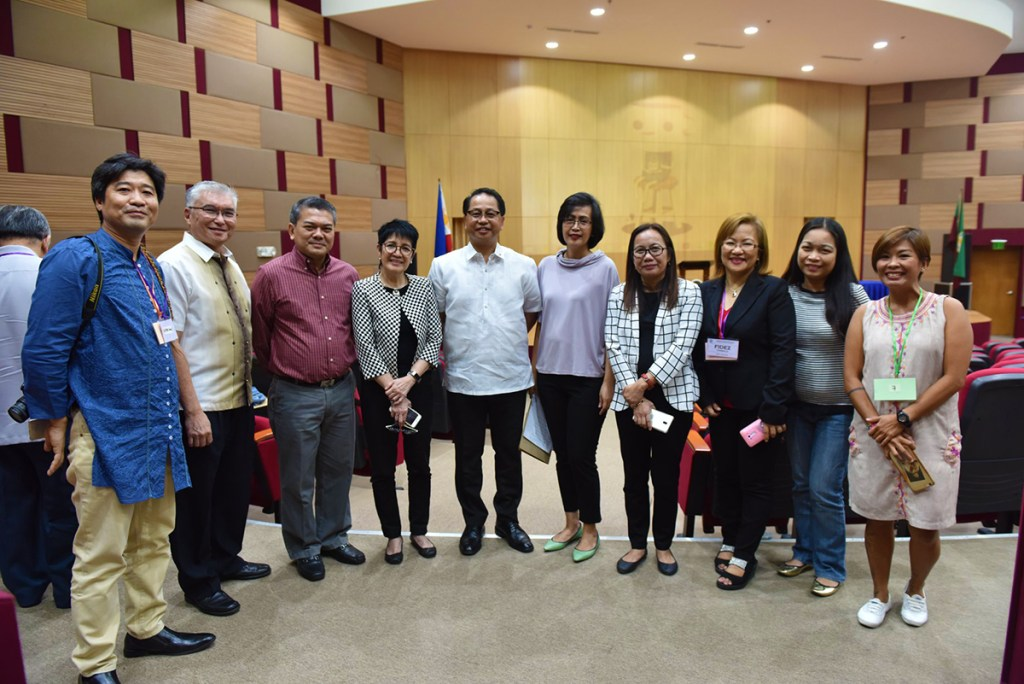 UP System officials pose with organizers and panelists at the Systemwide REPS conference. (Photo by Bong Arboleda, UP MPRO)