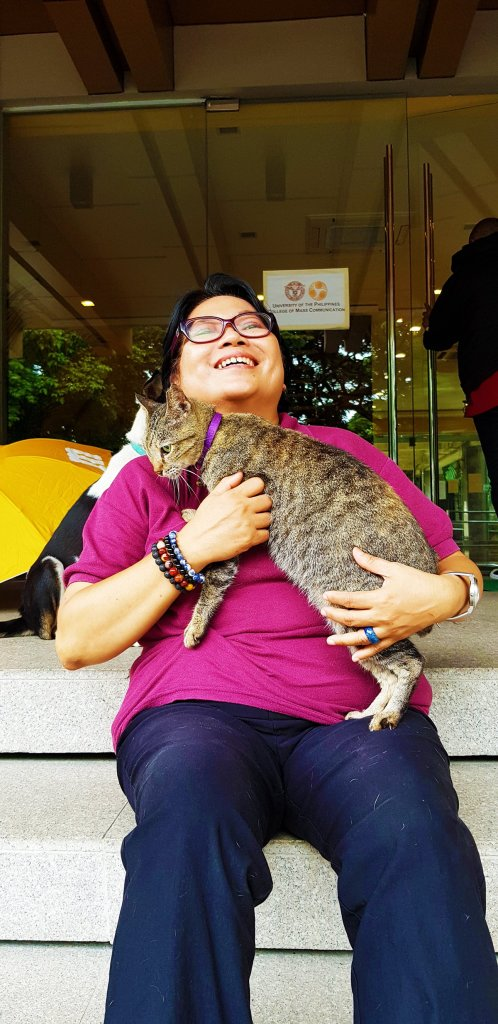Prof. Rara with Kit-Kat, the matriarch of the UP CMC's resident cats. (Photo by Celeste Llaneta, UP MPRO)