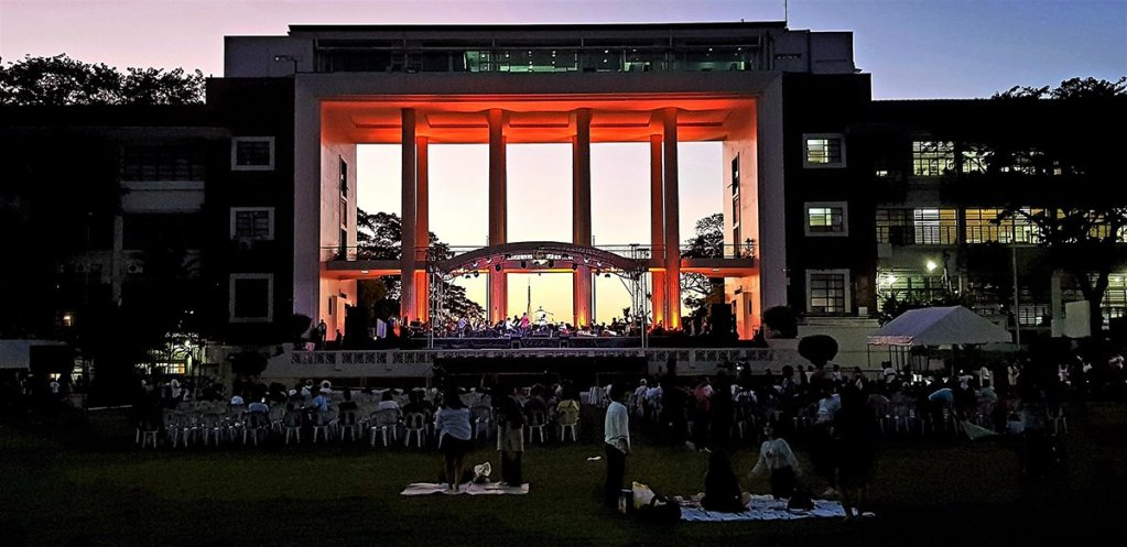 The community camps out early in the amphitheater while the concert ensemble does final checks on stage. (Photo by Jo. Lontoc, UP MPRO)