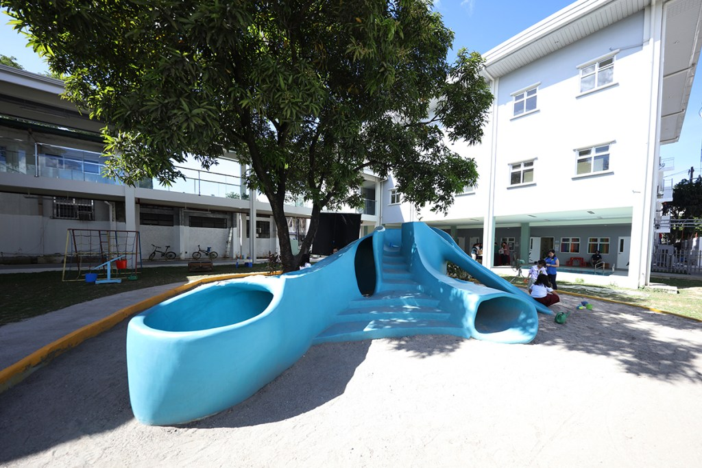 The CDC open-air playground highlighted by a slide said to be the work of Napoleon Abueva and a wading pool. (Photo by Misael Bacani, UP MPRO)