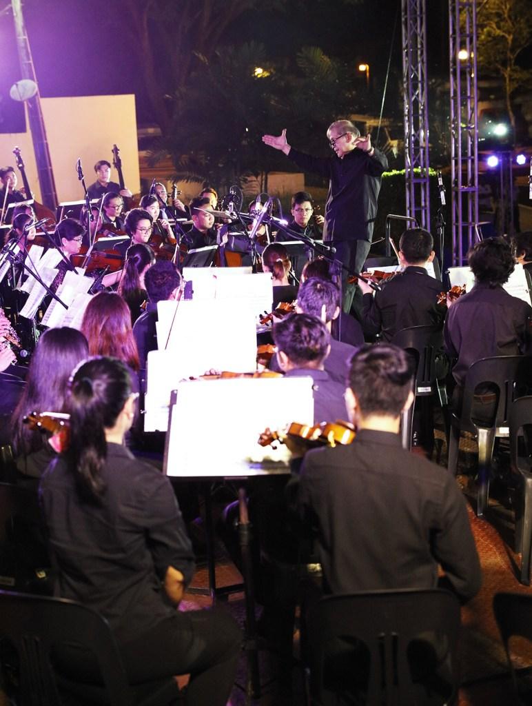 "Maestro Josefino ""Chino"" Toledo directs the UPSO's string section. (Photo by Misael Bacani, UP MPRO)"