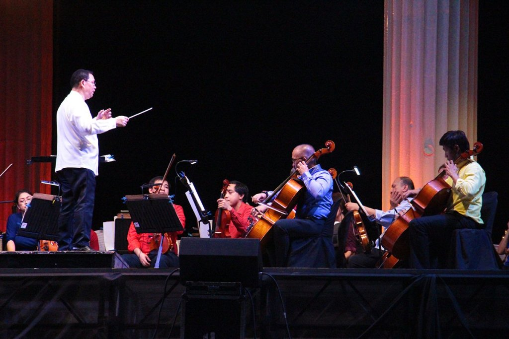 Maestro Herminigildo Ranera conducts the PPO. (Photos by Jun Madrid, UP MPRO)