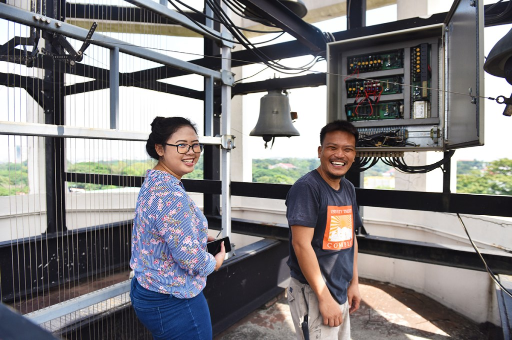 The UP Theater Complex's Henriette Baes and David Israel atop the Carillon tower (Photo by Bong Arboleda, UP MPRO)