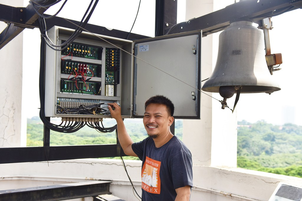 David Israel opening the electrical enclosure responsible for the Carillon's hourly magic. (Photo by Bong Arboleda, UP MPRO)