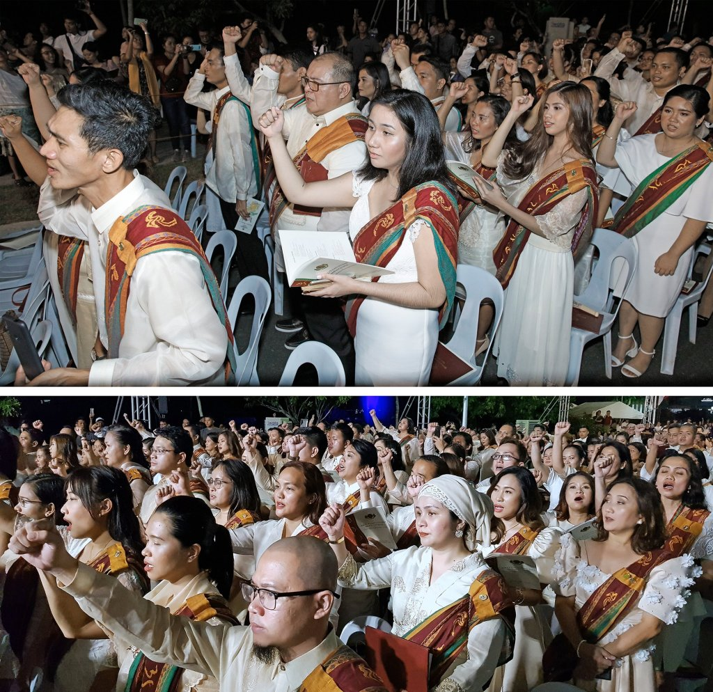 """The UPOU graduates raise their fists in the singing of """"UP Naming Mahal."""" (Top photo by Misael Bacani, UP MPRO and bottom photo by Arlyn VCD P. Romualdo, UP MPRO)"""