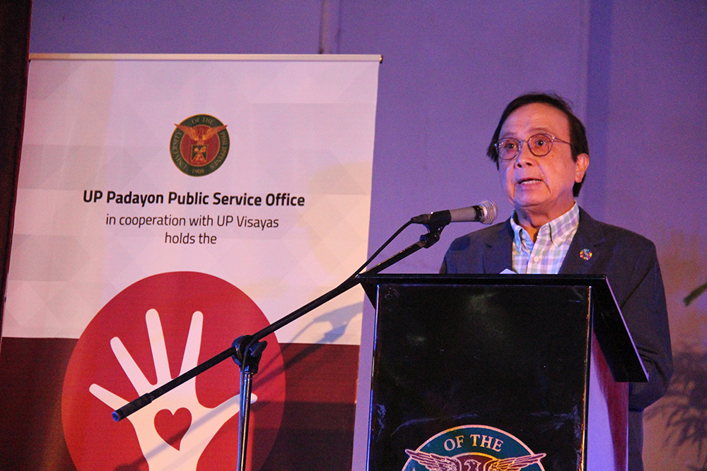 Delivering the keynote speech is National Economic and Development Authority Socio-economic Planning Secretary Ernesto Pernia. He underscores that research works and platforms such as CUPSCON deliver their primary role in uplifting poverty in the country. Photo by Jun Madrid, UP MPRO.