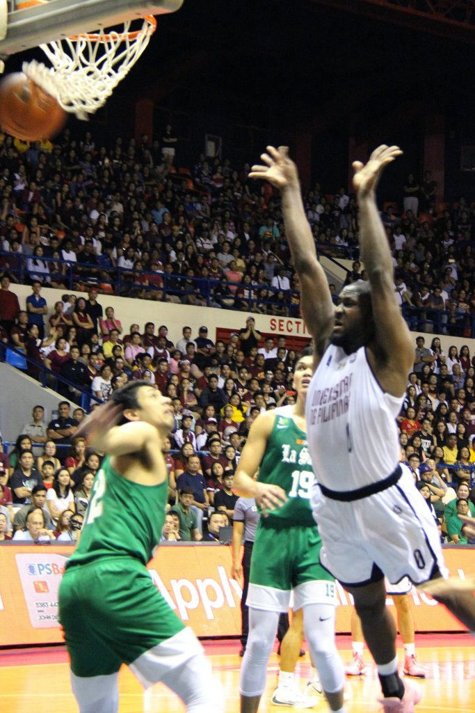 Bright Akhuetie falls after a bucket. Photo by Jun Madrid, UP MPRO