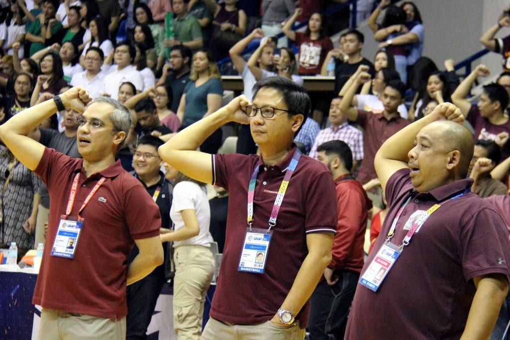 The playing of the UP Hymn restrains the emotions of the UP community for the moment. Photo by Jun Madrid, UP MPRO