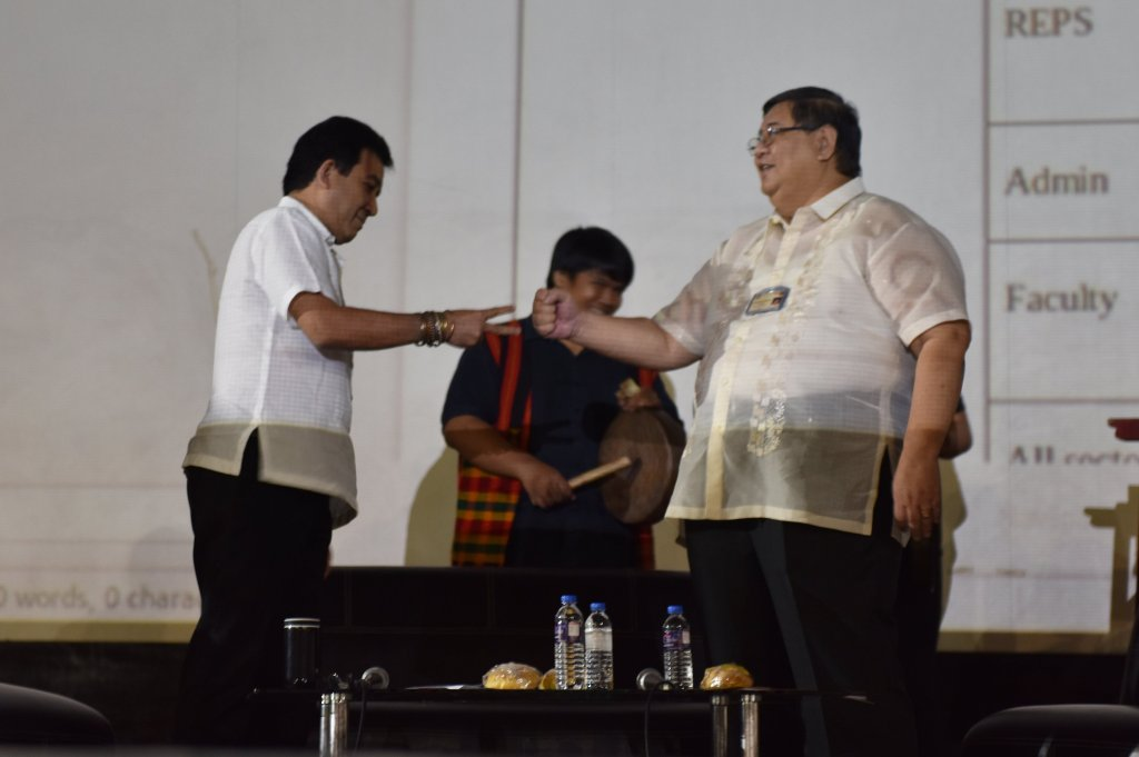 To decide which of them would be the first to present his vision and plans for UP Diliman, the two chancellor-candidates engaged in a game of rock-paper-scissors to the sound of a gamelan in the background. Photo by Bong Arboleda, UP MPRO.