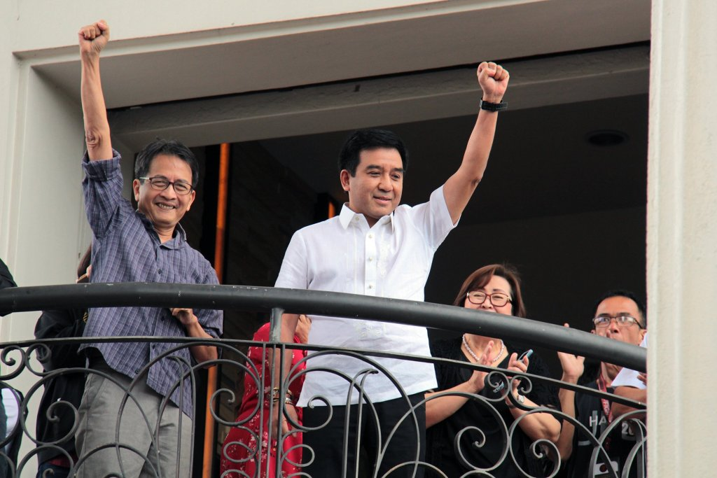 After the UP president's announcement of his chancellorship, Fidel Nemenzo (right) raises his fist, together with outgoing UPD Chancellor Michael Tan, on the Quezon Hall bridge before a multisectoral mobilization supporting him. Photo by Jun Madrid, UP MPRO.